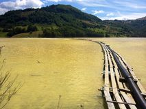 Polluted lake. Lake polluted with sulphur in Valea Sesii, near mining exploitation Rosia Poieni. Formerly Geamana village Stock Image