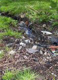 Polluted little river. Little river polluted by garbage Royalty Free Stock Photography