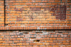 Polluted red brick wall texture. background, pattern Royalty Free Stock Photography