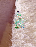 Polluted river. Plastic bottles in a red colored riverfall Stock Image