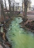 Polluted River. Green Polluted River in urban environment Stock Photos
