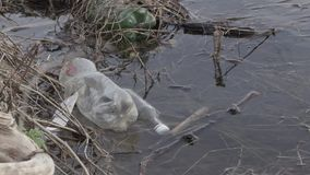 Polluted river bank. ecological disaster.  stock footage