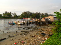 Polluted river and boat dock in Miri Sarawak Stock Photos