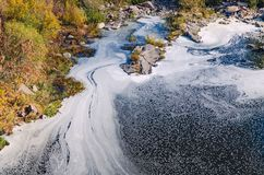 Polluted river, foam on the water surface top view stock photography