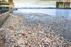 Polluted River full of garbage Stock Images