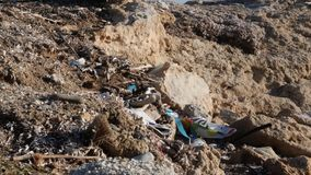 Polluted rocky beach filled with plastic and garbage. Environmental problems concept.  stock footage