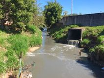 Polluted stream Stock Photo