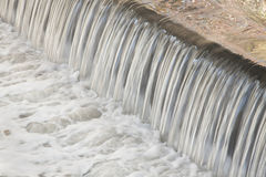 Polluted Water Falling Stock Images