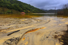Polluted water by mining Stock Photo