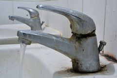 Polluted water tap Royalty Free Stock Image