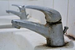 Polluted water tap Royalty Free Stock Photos