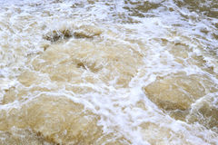 Polluted water drain into the river Stock Photo