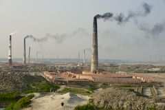 Polluting air brick factories pipes at Dhaka, Bangladesh. Stock Photography