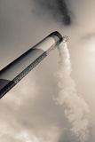 Polluting environment. Chimney polluting the environment. smoke from factory Stock Images