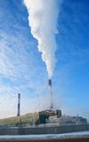 Polluting Factory. A view of a factory chimney smoke, polluting the environment Stock Photo