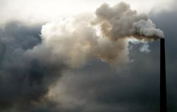 Polluting Smokestack. This image shows a polluting smokestack Royalty Free Stock Photography