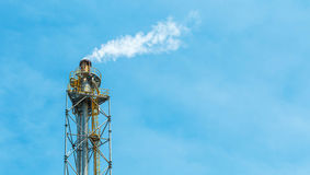 Polluting white smoke coming out of chimney Royalty Free Stock Photos
