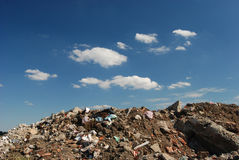 Pollution 05. Different waste  over blue sky and clouds Royalty Free Stock Photography