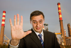 Pollution. Businessman with open hand making stop to pollution royalty free stock photos