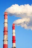 Pollution. Smoke from chimneys of a factory making pollution Stock Photos