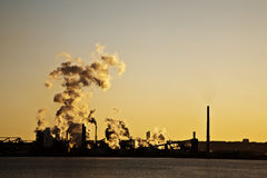 Pollution. Industrial pollution and sunset by the lake Royalty Free Stock Images