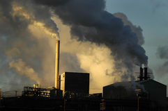 Pollution. Smokestacks from a factory spewing smoke and pollution into the air Stock Images