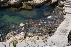 Pollution. Of clear sea water Royalty Free Stock Photo
