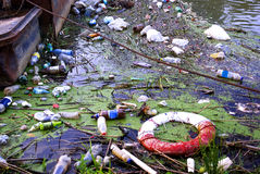 Pollution. Water pollution, plastic bottles and garbage on river surface Stock Photos