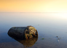 Pollution. Industrial waste left on the coast - great pollution photo taken at dusk Stock Image
