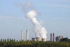 Pollution. Power station smoking to the air Royalty Free Stock Images