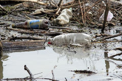 Pollution. Dirty river pollution with plastic bag Royalty Free Stock Image