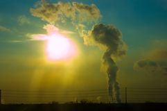 Pollution. Heavy smoke covering the sun shot against a deep blue sky Stock Images