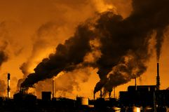 Pollution Air Quality Factory Smoke Pumping Into Atmosphere Environment. Pollution poor air quality factory smoke stacks environment stock photo