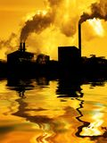 Pollution Air Quality Factory Smoke Pumping Into Atmosphere Environment Water Reflection. Pollution poor air quality factory smoke stacks environment water royalty free stock image