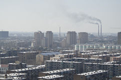 Pollution in Asia. Pollution and smog over a small steel manufacturing city north of Beijing, China Royalty Free Stock Photography