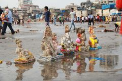 Pollution on the beach. Apathy of Broken plaster idols litter on the beach around Mumbai, India Royalty Free Stock Photo