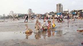 Pollution on the beach. Apathy of Broken plaster idols litter on the beach around Mumbai, India Stock Photos