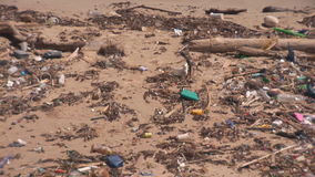 Pollution on a beach. Articles washed ashore on a beach on Bonaire, The Netherlands stock video footage
