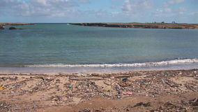 Pollution on a beach. Articles washed ashore on a beach on Bonaire, The Netherlands stock video