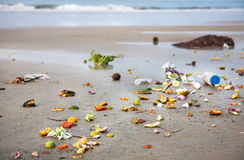 Pollution on the beach in India. Pollution on the beach near by ocean in Varkala, Kerala, India Stock Photo