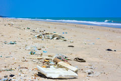 Pollution on the beach of tropical sea. Outdoors. Royalty Free Stock Images