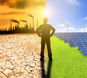 pollution and clean energy concept. businessman watching windmills solar panels and refinery with air pollution