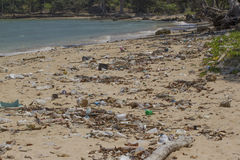Pollution of coastal ecosystems, natural plastic. Beach on the island of Little Andaman in the Indian Ocean littered with plastic. Pollution of coastal Royalty Free Stock Photo