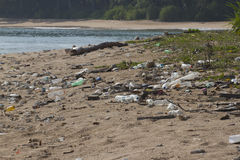 Pollution of coastal ecosystems, natural plastic. Beach on the island of Little Andaman in the Indian Ocean littered with plastic. Pollution of coastal Royalty Free Stock Photography