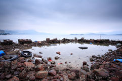 Pollution on coastline. Some wasted stuffs at the coastline Stock Photo
