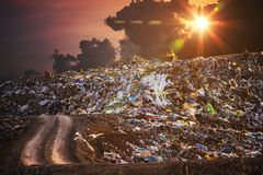 Pollution concept. Garbage pile in trash dump or landfill at twilight stock photo