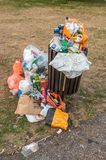 Pollution concept. Overflowing trash bin in park. 3rd August 201 Stock Image