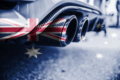 Pollution of environment by combustible gas of a car with blending Australia flag Royalty Free Stock Photography