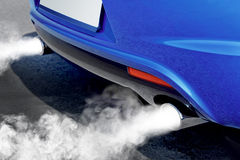 Pollution of environment from powerful car Stock Photography