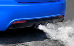 Pollution of environment from powerful sport car Royalty Free Stock Photo